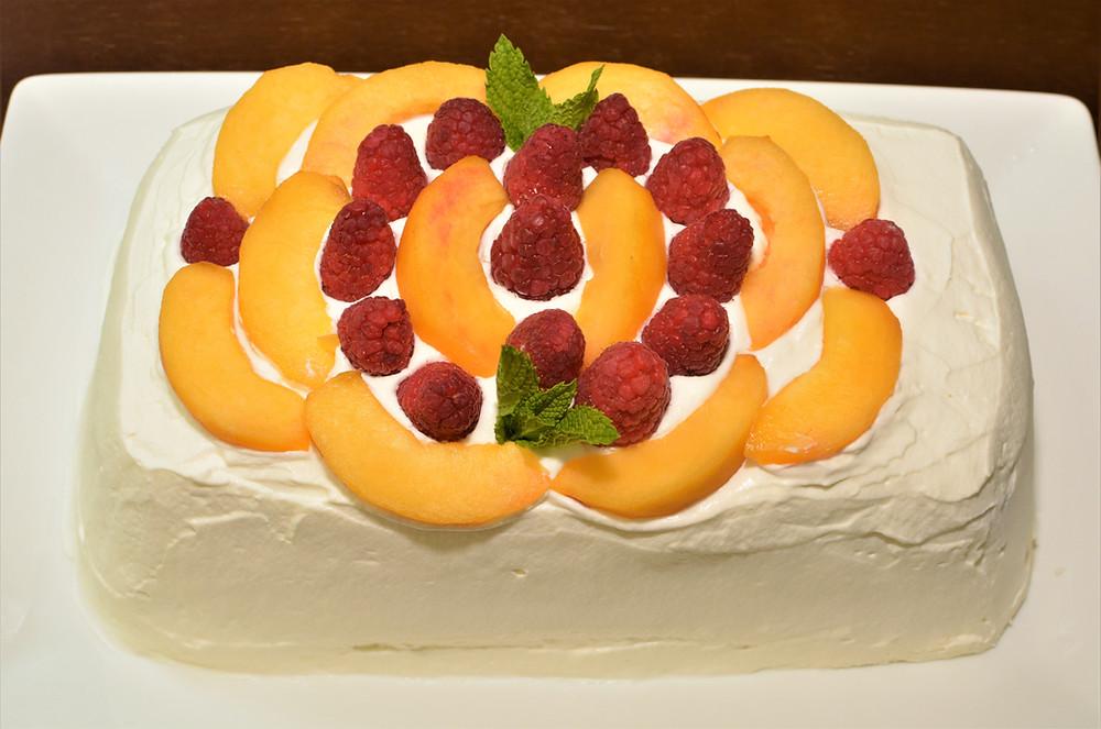 Decorated Raspberry Peach Icebox Cake with Whipped Cream