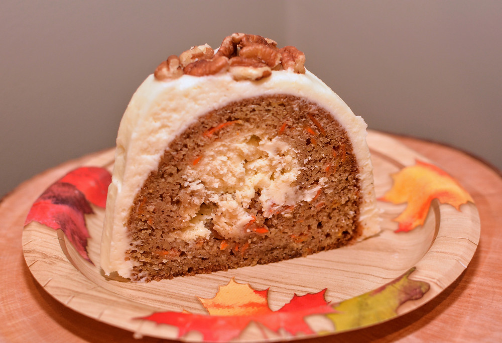 Slice of Carrot Cake Surprise Bundt Cake with Cream Cheese Frosting