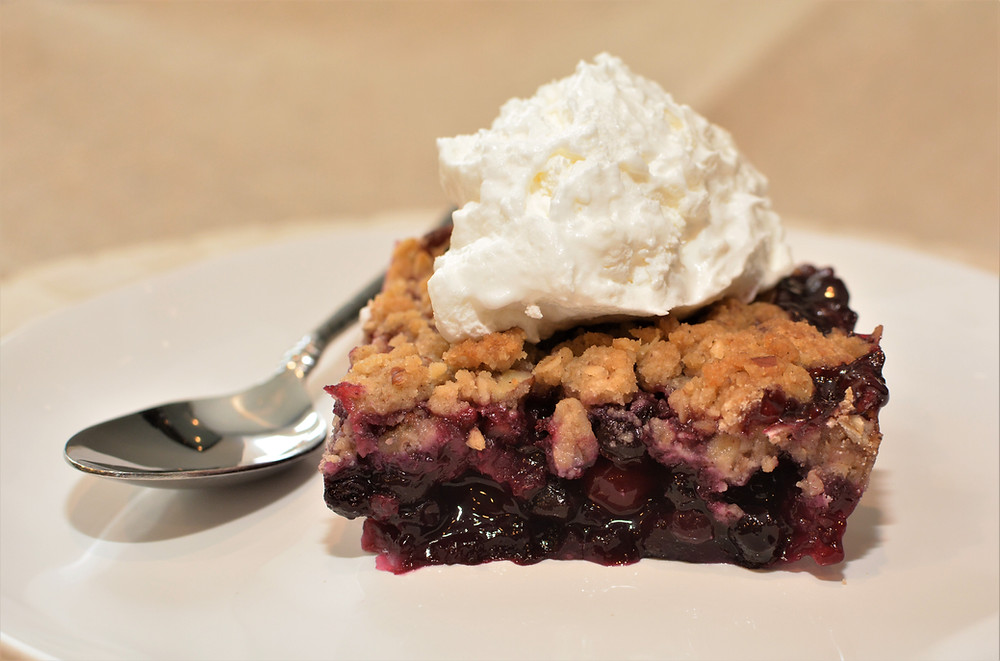 Juicy Cranberry Blueberry Maple Crisp with Whipped Cream