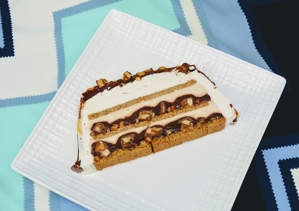 Snickers Icebox Cake with Caramel Chocolate Topping