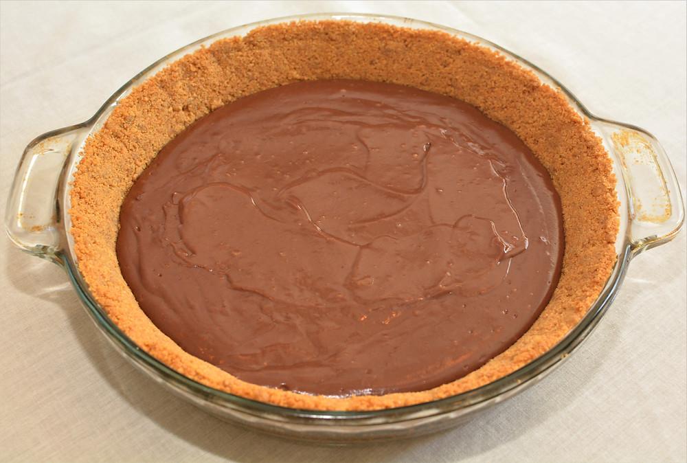 Graham Cracker Crust and Chocolate Pudding Layers of Heath Bar Cheesecake Pie