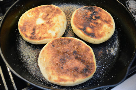 Homemade English Muffins Cooked until Golden Brown