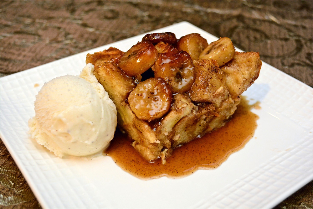 Bananas Foster Bread Pudding served with Rum Caramel Sauce