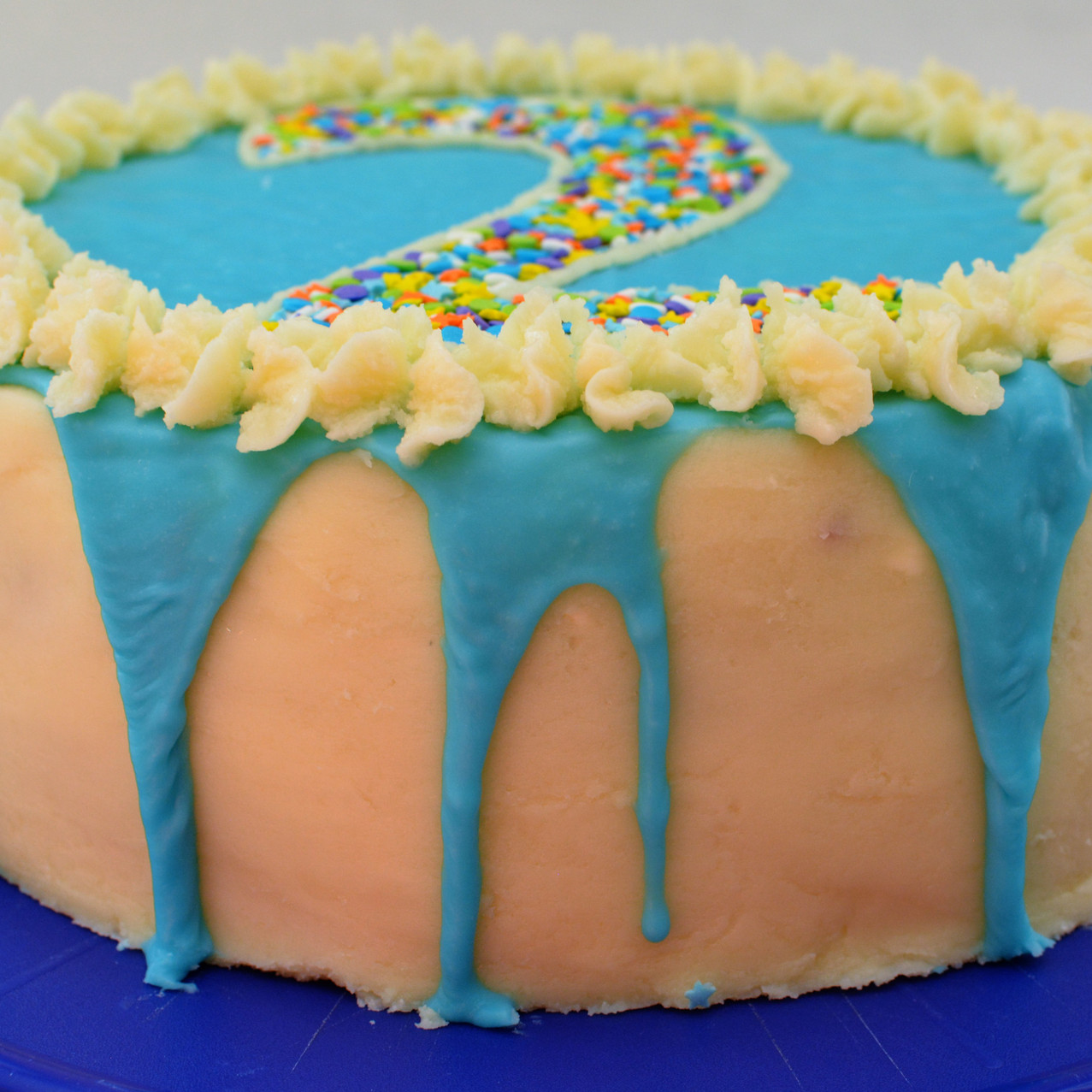 Blue Colored White Chocolate Ganache for Double Layer Funfetti Cake with Buttercream Frosting