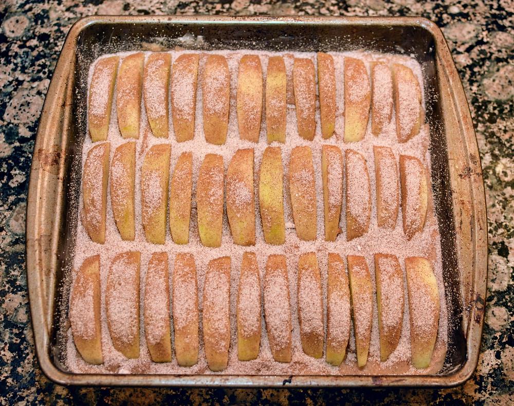 Cinnamon sugar sprinkled on top of Apple Cider Cake batter