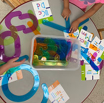 Early literacy skills-learn letters by creating their shapes with toys.