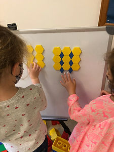 Learn math skills by creating patterns with a friend.