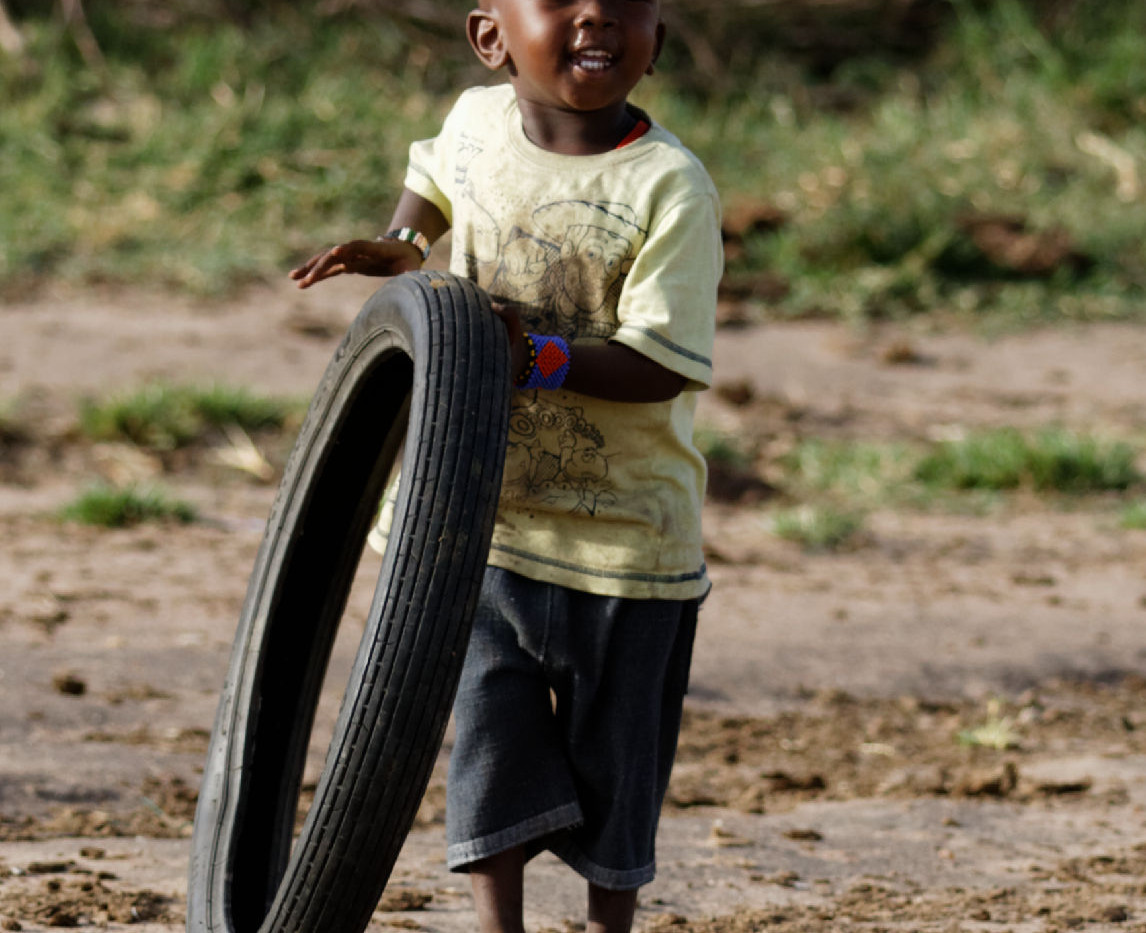Kenya Boy with tire