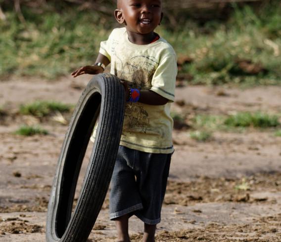 Kenya Boy with tire