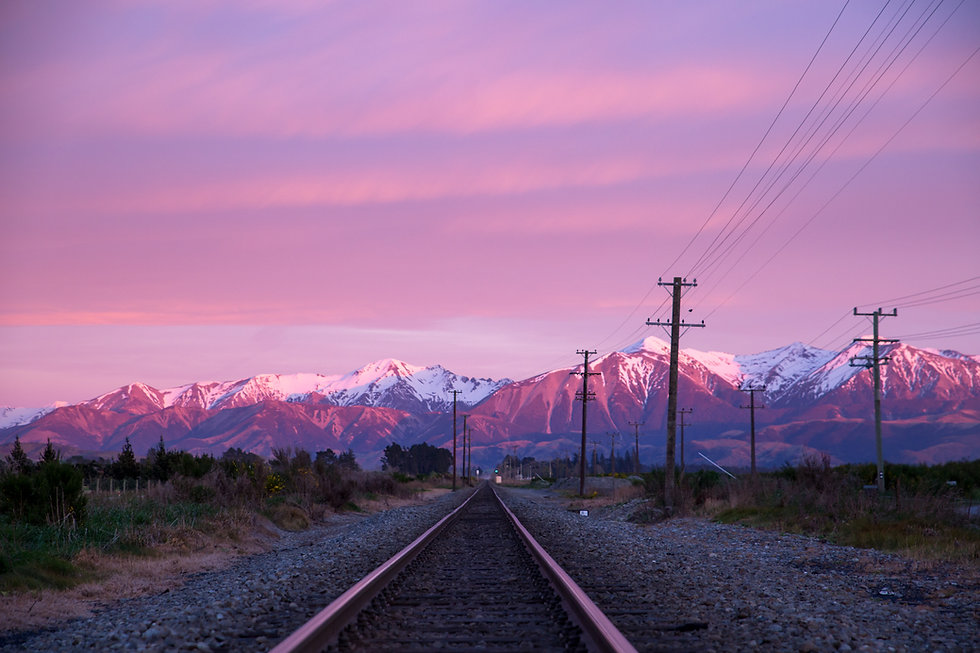 A pink sunrise over the snowy mountains