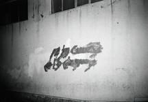 Effaced Green Movement graffiti in Tehran