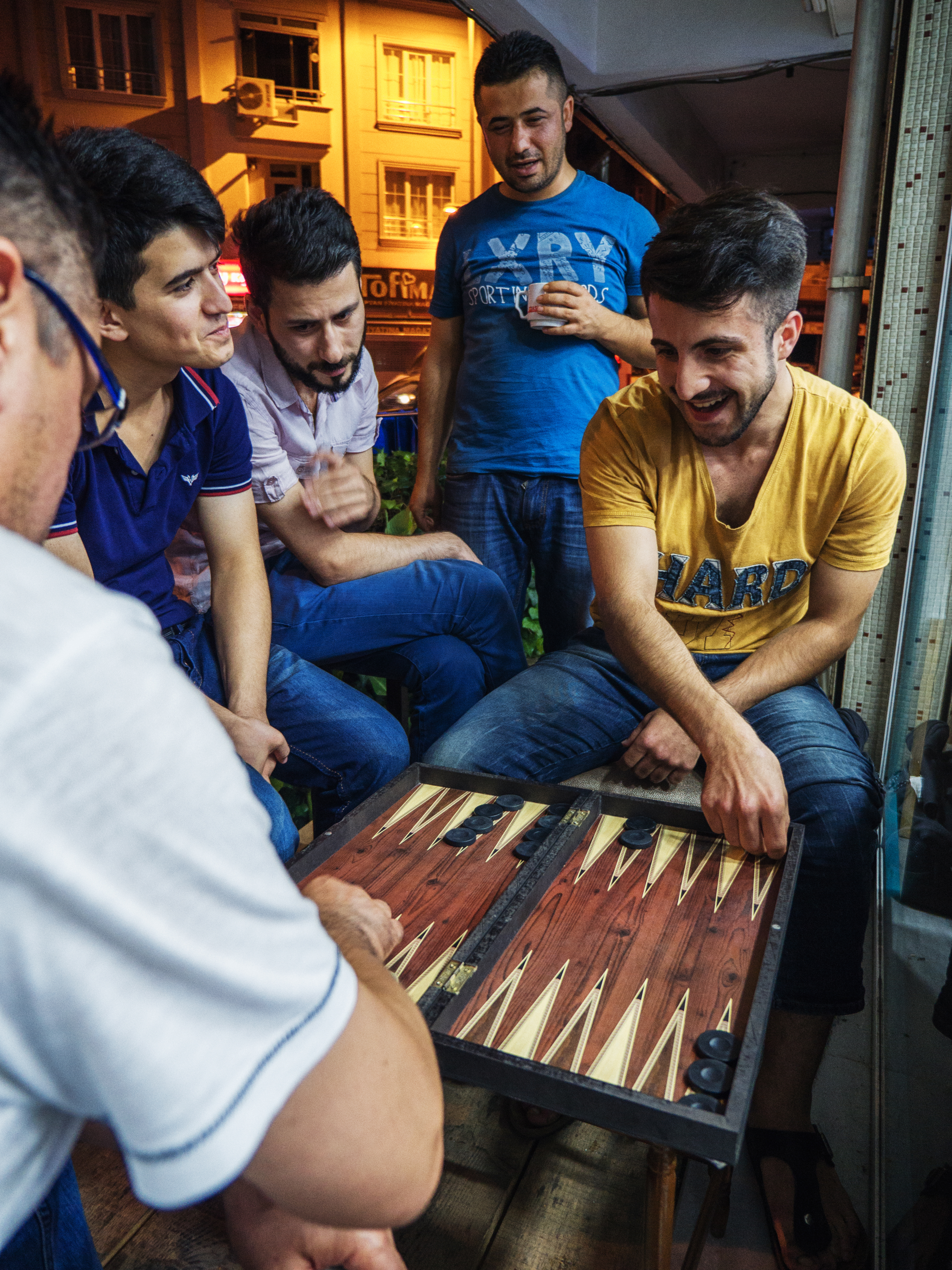 Mehmet plays backgammon at work