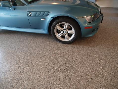 Blue BMW on Coated Concrete Floor