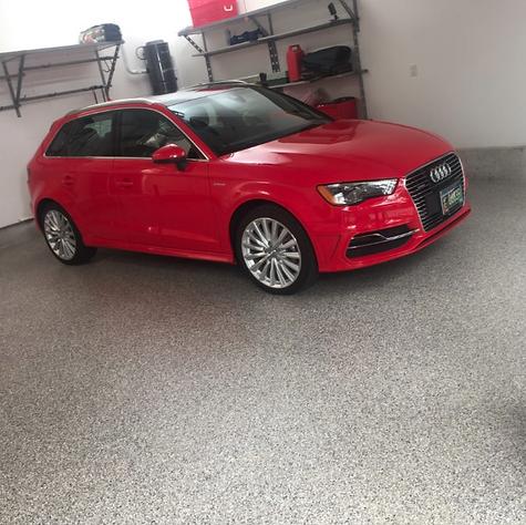 Red Audi on Coated Garage Concrete Floor