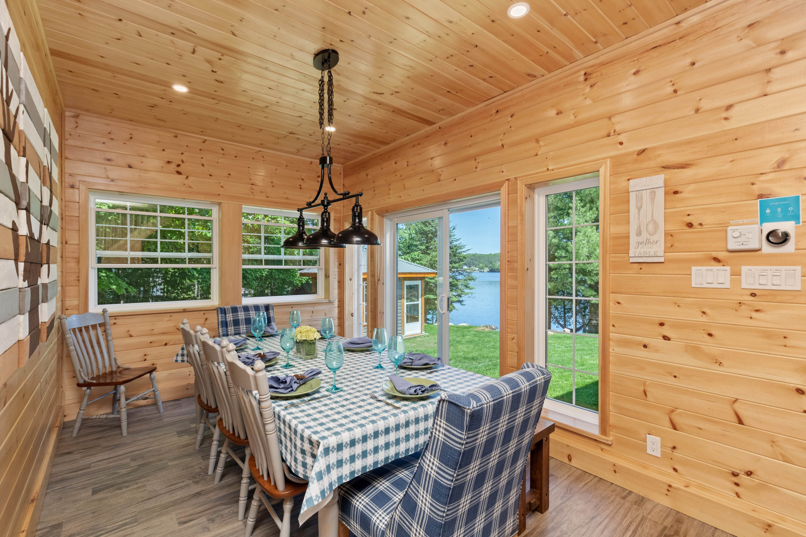 Charming Muskoka dining room with lakefront view