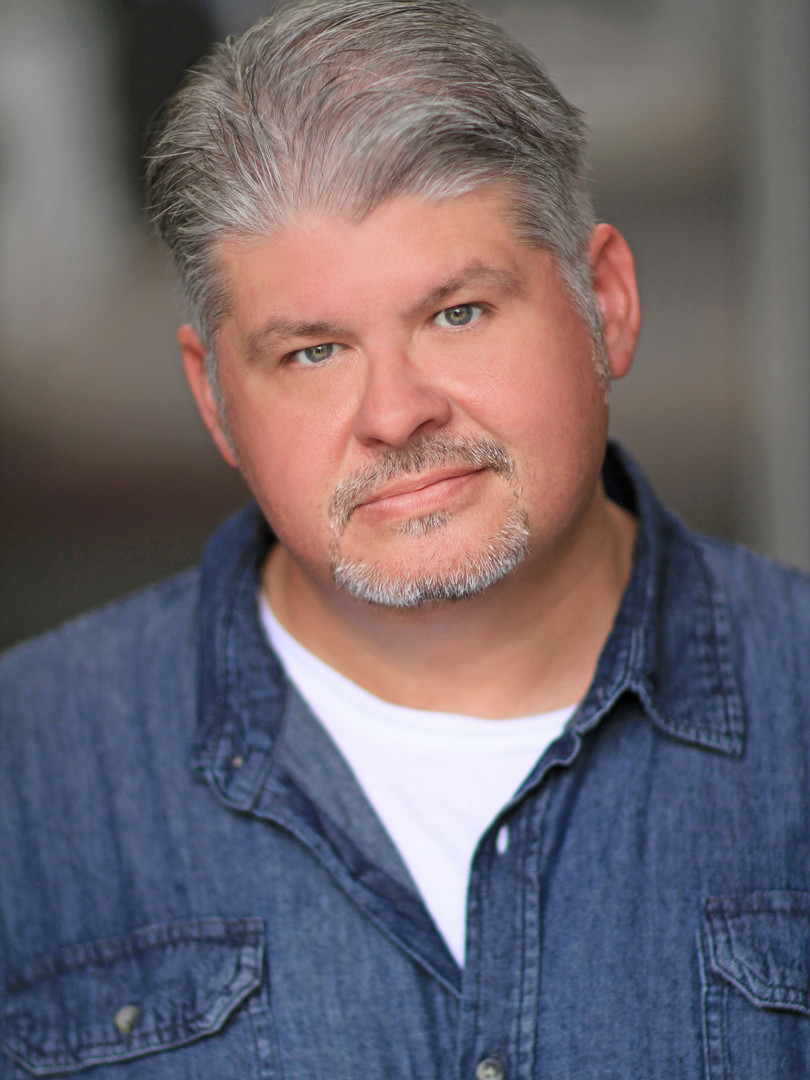Chester Goad Headshot 1 Blue.jpg