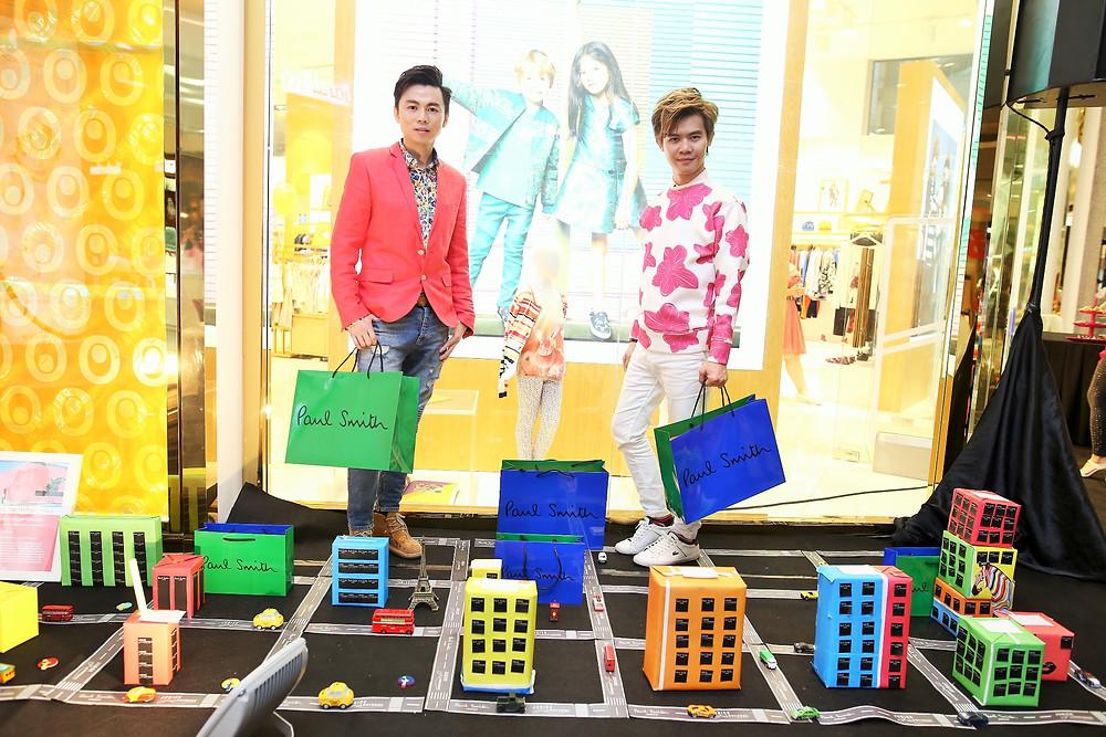 Mr. Brian John Yim and Mr. Matthew Benjamin Yoon pose inside mini multicolour city