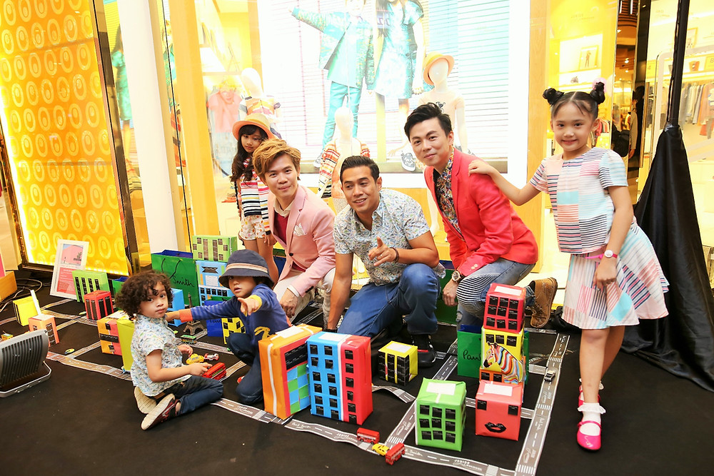 Mr. Matthew Benjamin Yoon, Mr. Amar Asyraf (with his son Amar Taufiq, kid boy from the left), Mr. Brian John Yim pose inside mini multicolour city