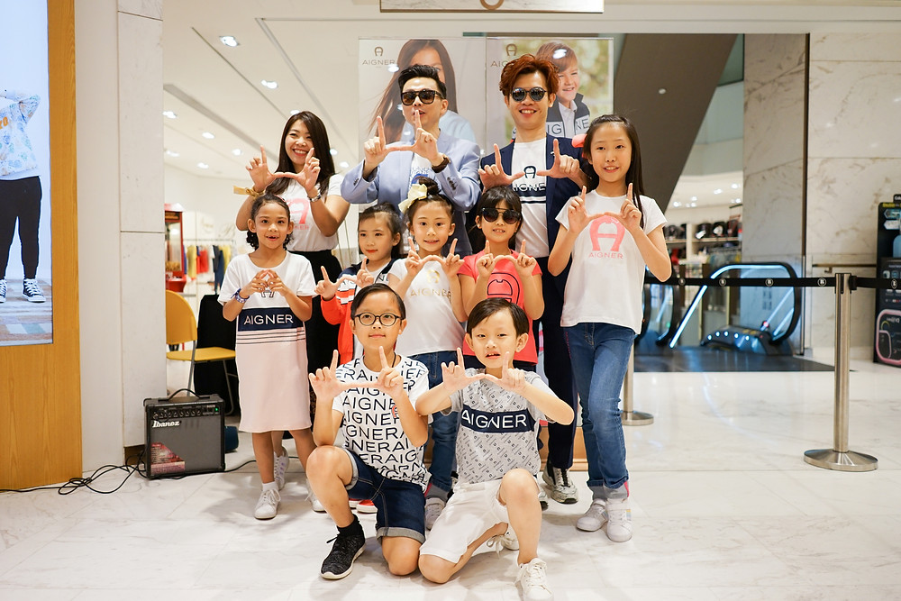 Ms. Alice Chang, Mr. Brian John Yim and Mr. Matthew Benjamin Yoon with kids model in AIGNER KIDS collection