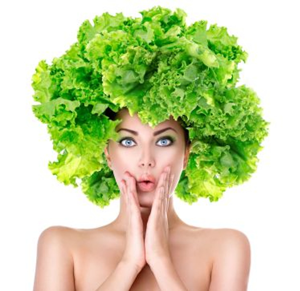 35403198 - surprised girl with green lettuce hairstyle. dieting concept