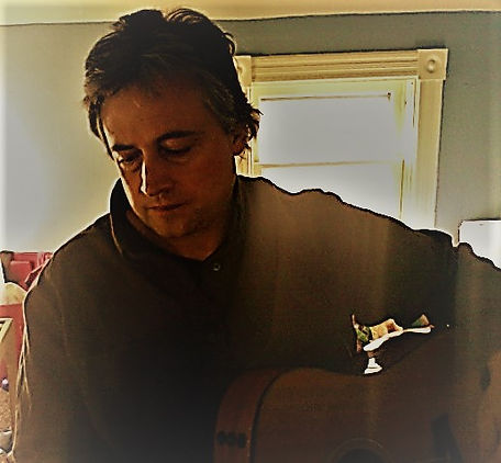 Rick Brix with Guitar in Playroom.JPG