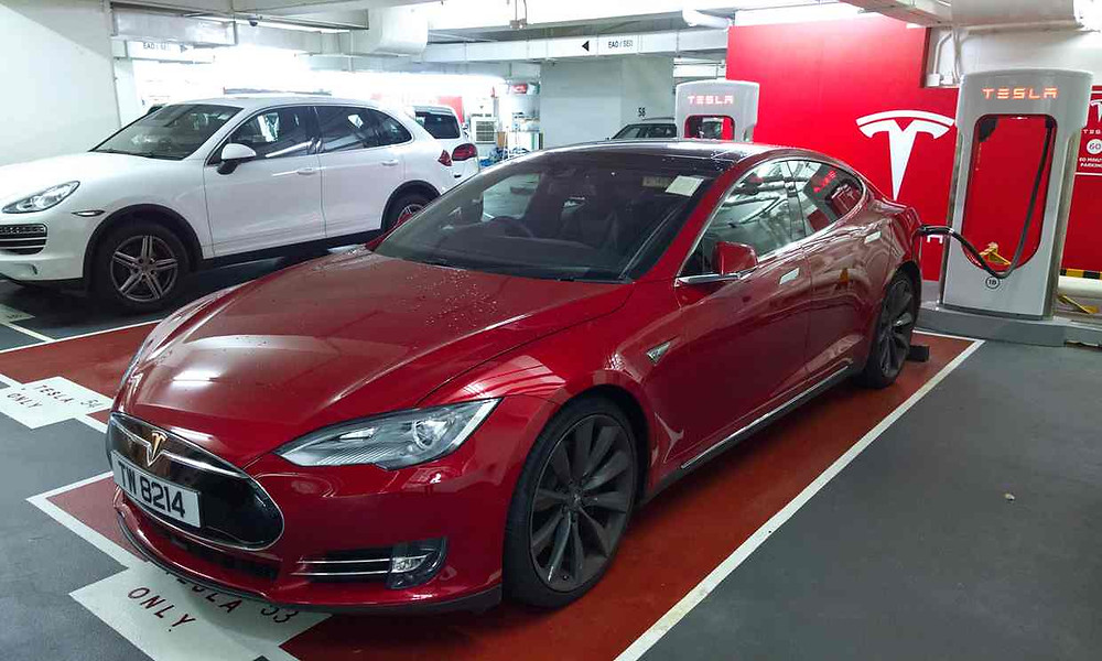 As soon as Tesla entered the market in Hong Kong, the numbers of EVs-to-station ratio jumped significantly. Meaning more queues at charging stations. Photograph: Guardian/Brady Ng