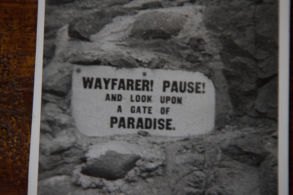 The sign at the crest of the Gate of Paradise pass
