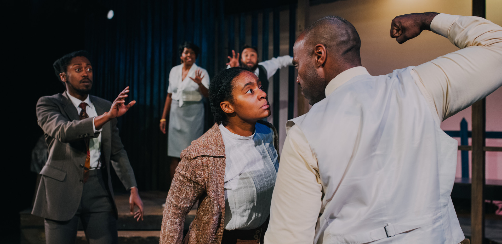 Harpo watches as Cellie (Jessica M. Johnson) stands her ground against Mister (Tyson Janette)