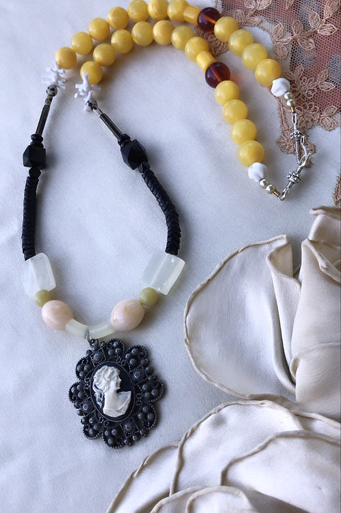 Golden orb portrait necklace