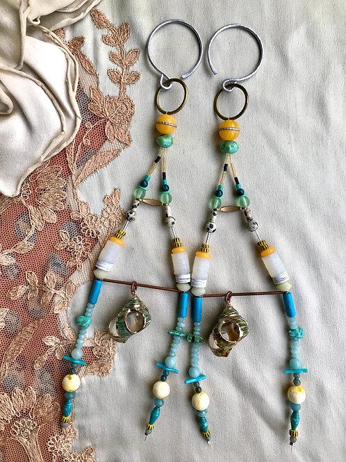 Kite tail sea shell gauged earrings