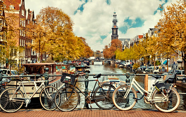 Bike over canal Amsterdam city. Pictures