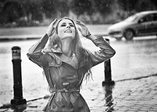 Beautiful woman wearing a coat posing in