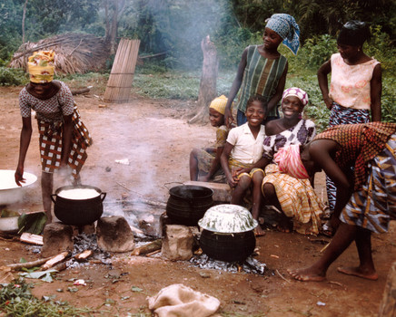 The quintessential scene of Liberian life circa 1967: females, young or old, cooking rice— in this case my students after school, with their million-dollar smiles.