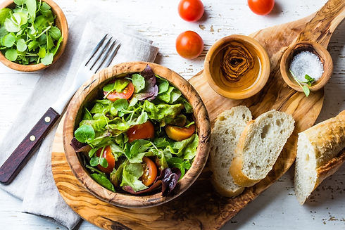 Healthy salad served in a Jamailah olive wood bowl