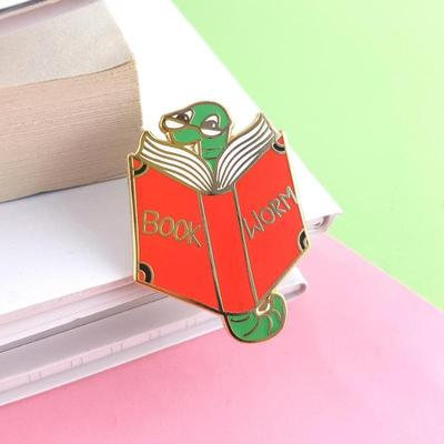 Book worm lapel pin