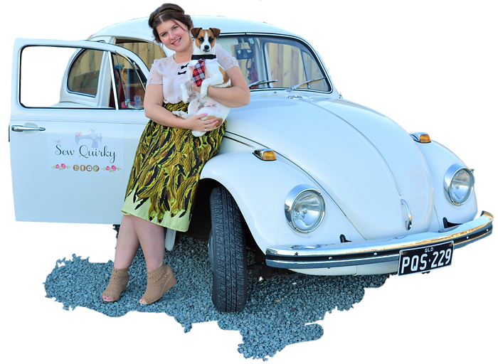 Sew Quirky standing with 1970 VW Beetle car. Sew Quirky signage on car.