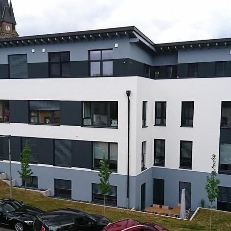 Neubau eines Wohn- und Geschäftshauses in Rosbach