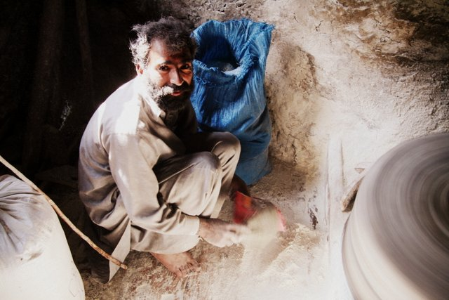 A flour mill worker tends to his water-powered stone mill. Kaghan Valley is filled with timeless mills that take you back many decades to the days before electricity.