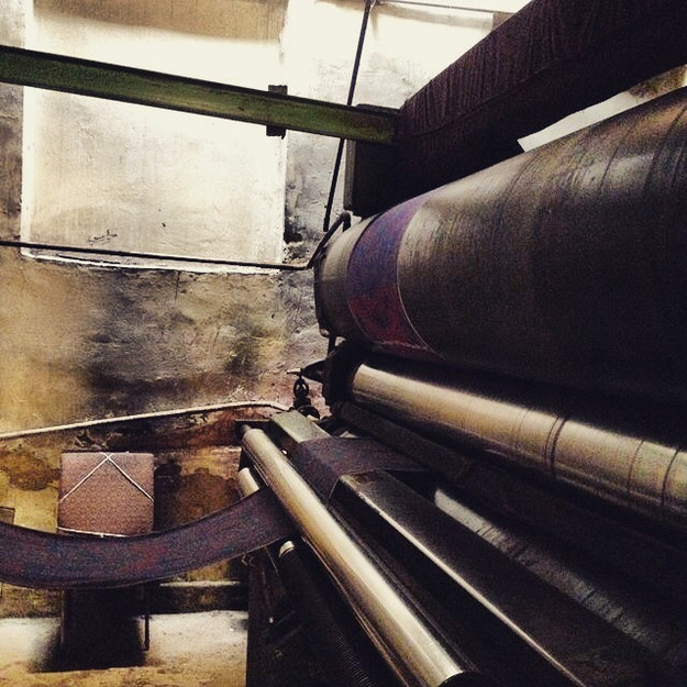 Once the textile weaving has been completed, it is ironed. In Margilan, the Yodgurlik silk factory has 2 units of old Soviet steam rollers, and the master weavers of the city rent these rollers to get a consistent ironing of their hundreds of meters of yardage.