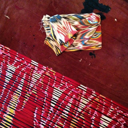 The thread bundles, in the process of being tied and dyed, and the finished cloth. It's no wonder that some cultures believe ikat is imbued with magical properties due to the time and skill involved in creating it.
