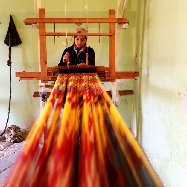 The threads are loaded onto a simple treadle loom, where 2-4 peddles are manipulated by the weaver to adjust the warp. Unlike other hand woven fabrics, where the complexity of the weave depends upon the skill of the weaver, the weaving of Central Asian ikats is relatively simple. The main role of the weaver is to ensure the correct tension and watch for any broken threads. If a thread is broken, the weaver must immediately knot it back together to ensure the pattern is not broken.