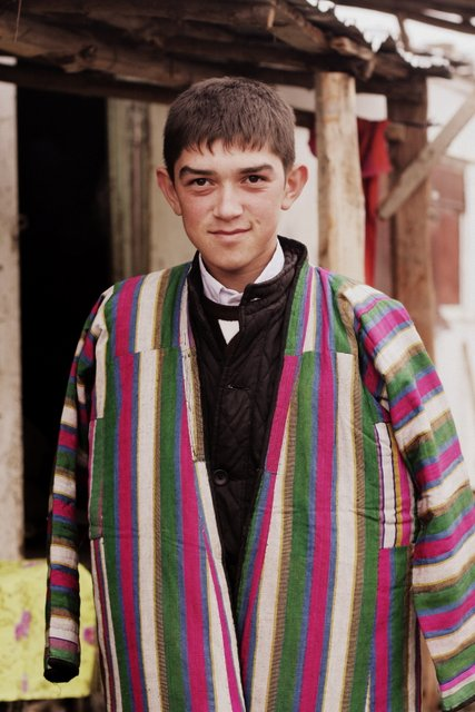 A young boy in a traditional chapan in Urgut