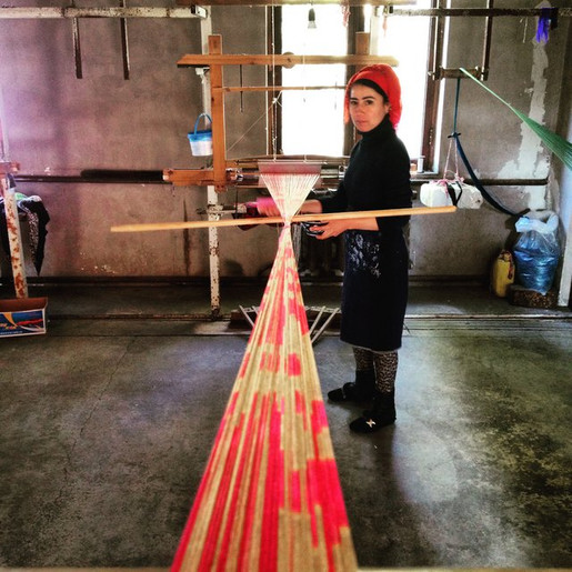 Central Asia ikats are warp-dyed, so the loom is loaded with the dyed threads; the weft thread (the thread in the shuttle which passes from right to left) will be a plain colour and made from silk or cotton. White and black weft thread is common, but some masters use other colours, such as pink, to give a rosy hue to the final textile.