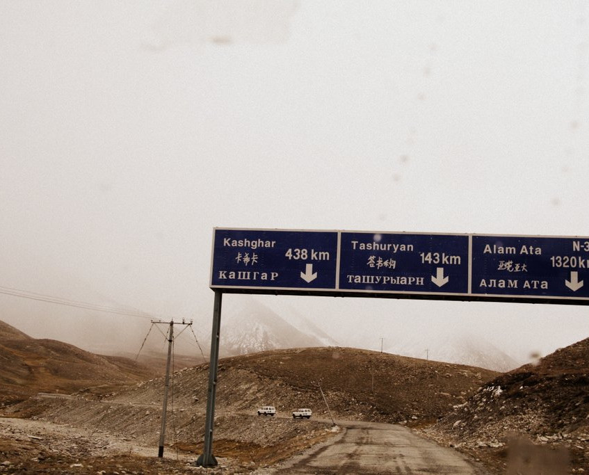 Road sign to Kashgar and Taxkorgan in China, and Kazakhstan.