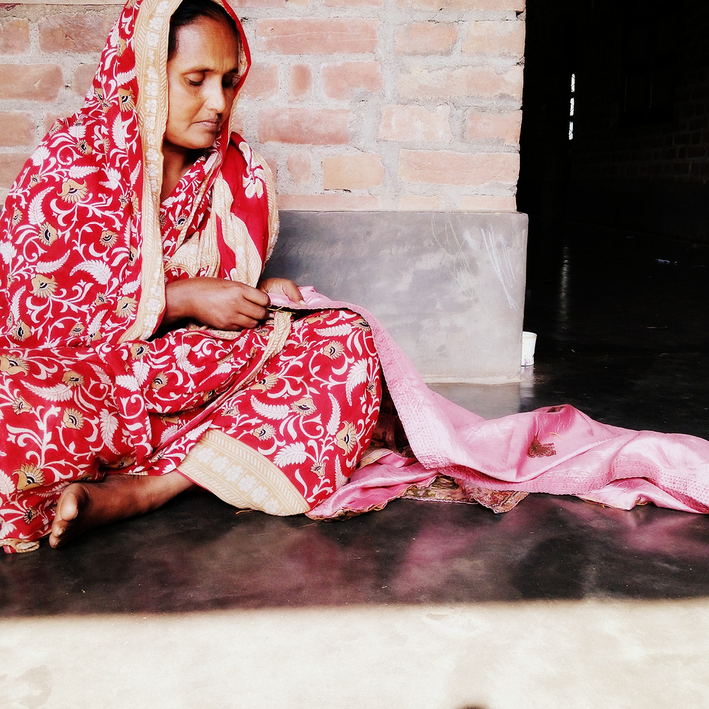 An artisan does kantha hand embroidery in West Bengal