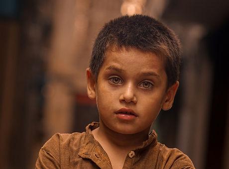 Photo by Aqib Shahid Boy Wearing Brown L