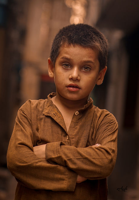 Photo by Aqib Shahid Boy Wearing Brown L