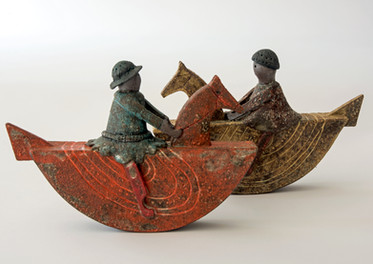 A pair of small rocking horses with riders