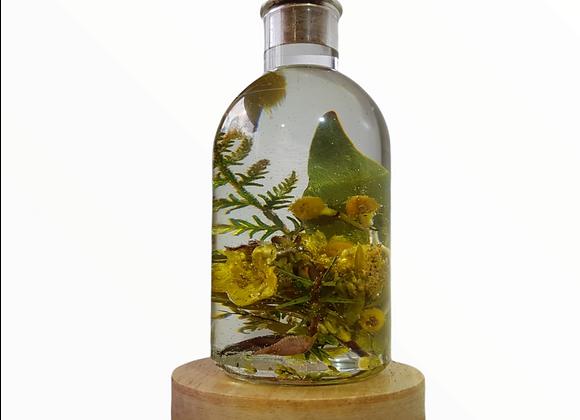 Native floral arrangement bottled lamp