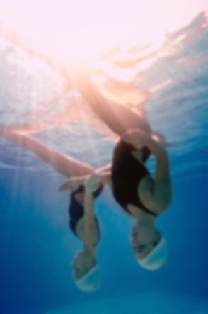 Low angle underwater view of synchronize